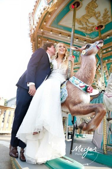 bride and groom on carousel smithville nj