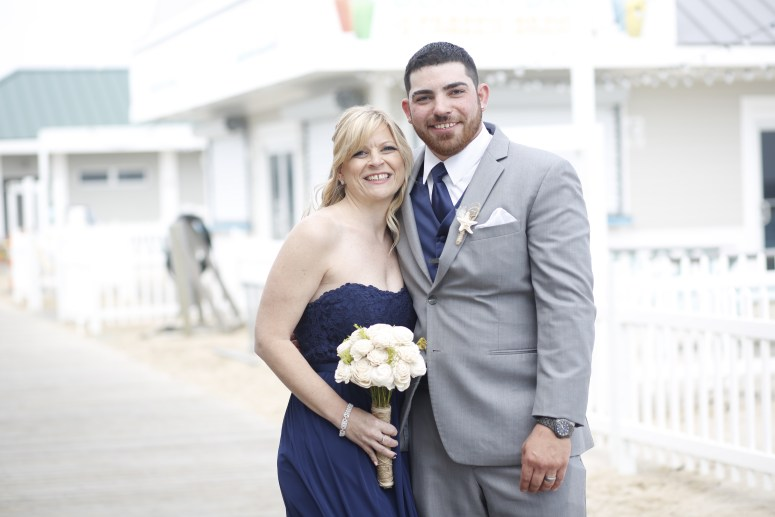 groom and bridesmaid smiling