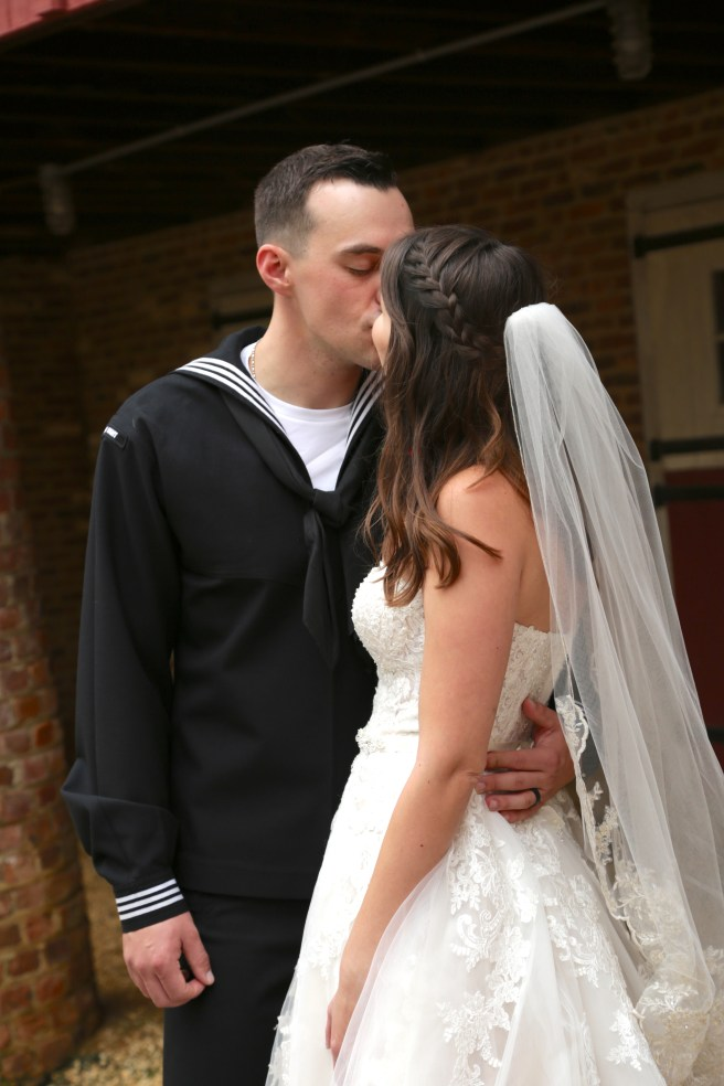 the bride and groom kissing
