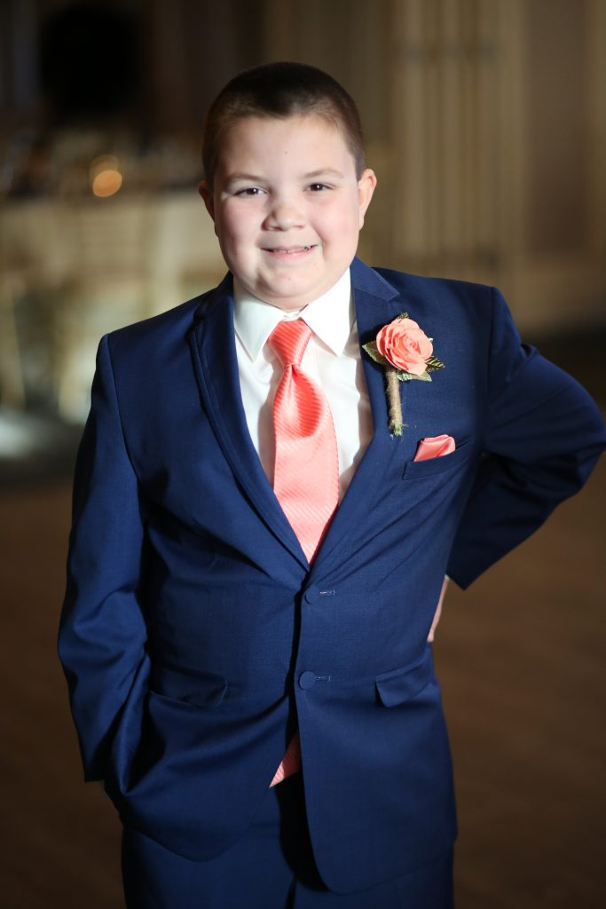 child in blue suit at wedding in 2019