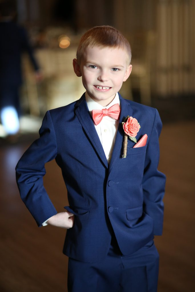 child in a blue suit at wedding in 2019