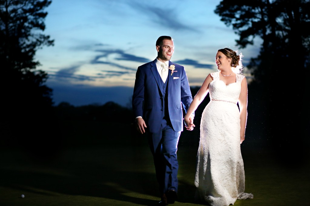 bride and groom walking away from a sunset at a wedding in 2019