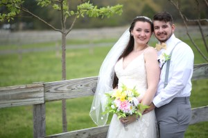 bride and groom standing at farm in NJ