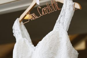 wedding dress on a hanger at wedding in 2019