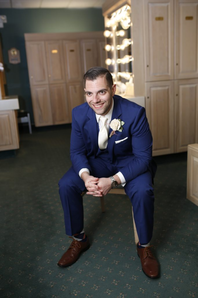 groom at wedding in 2019