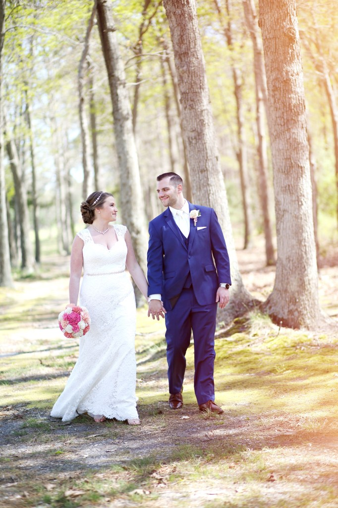 bride and groom walking through the New Jersey forest at a wedding in 2019
