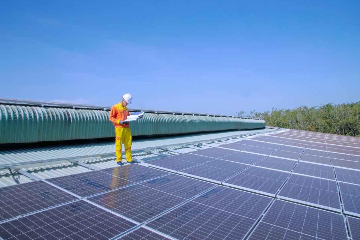 solar technician installing solar panels