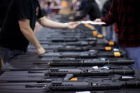**ADVANCE FOR WEEEKEND, APRIL 12-13** A row of weapons is seen at the Richmond Gun Show at the Richmond International Raceway on Sunday, March 30, 2008. (AP Photo/Casey Templeton)