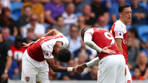 CARDIFF, WALES - SEPTEMBER 02: Alexandre Lacazette of Arsenal (9) celebrates with Pierre-Emerick Aubameyang as he scores his team's third goal during the Premier League match between Cardiff City and Arsenal FC at Cardiff City Stadium on September 2, 2018 in Cardiff, United Kingdom. (Photo by Catherine Ivill/Getty Images)