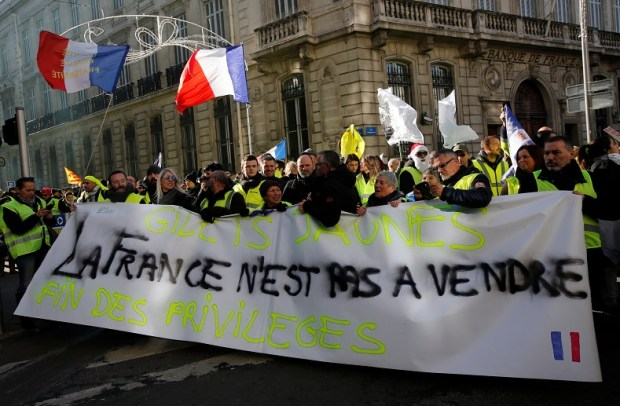 """Protesters wearing yellow vests take part in a demonstration of the """"yellow vests"""" movement in Marseille"""