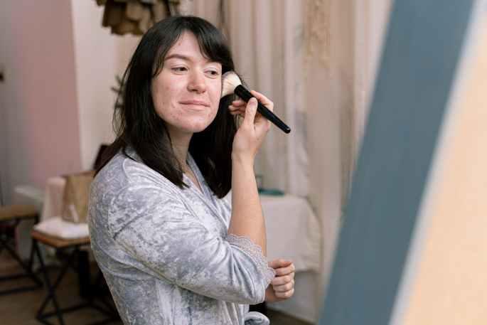 a woman putting makeup