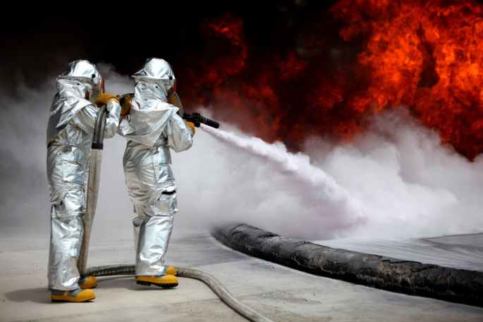 firefighters extinguishing blazing fires