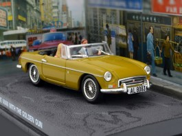 """This is a very cool 1/43 diecast MGB roadster in Mustard Yellow as featured in the 1974 James Bond film """"The Man with the Golden Gun"""" starring Roger Moore as 007."""