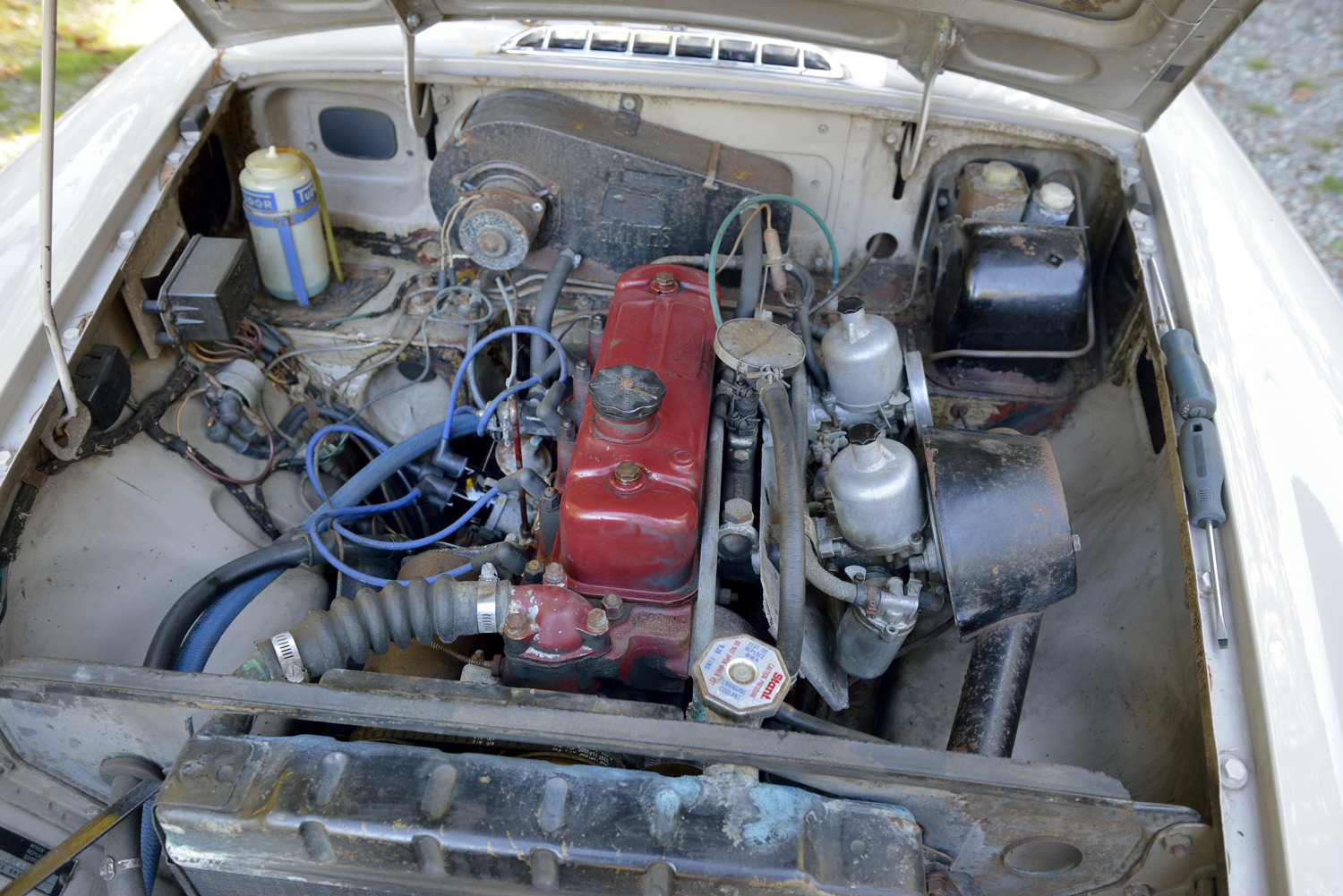 1967 MGB GT engine compartment before cleaning