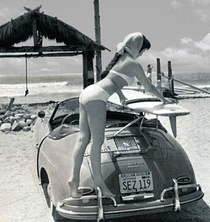 Bikini chick withh surfboard and Porsche