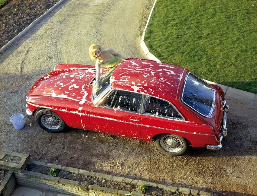 Hot girl washing an MGB GT