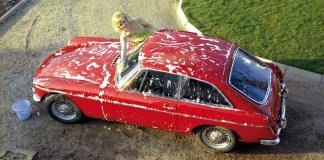 Hot girl washing MGB GT