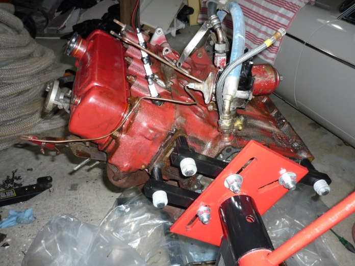 MGB GT engine on stand