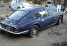 Triumph GT-6 in a sandbox