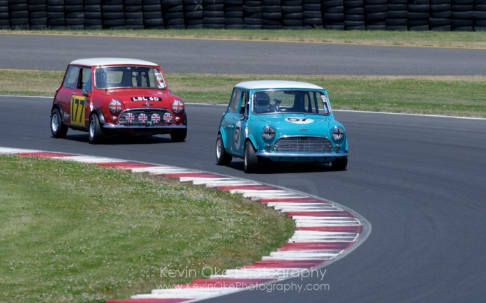 A couple of Austin Minis in action