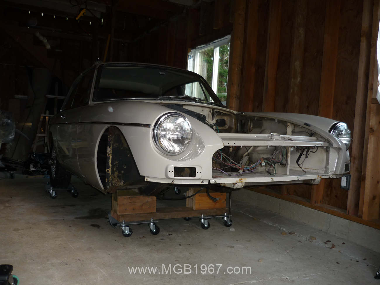 1967 MGB GT supported on car dollies | 1967 MGB GT