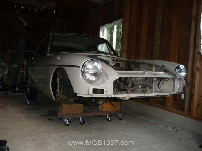 1967 MGB GT supported on car dollies