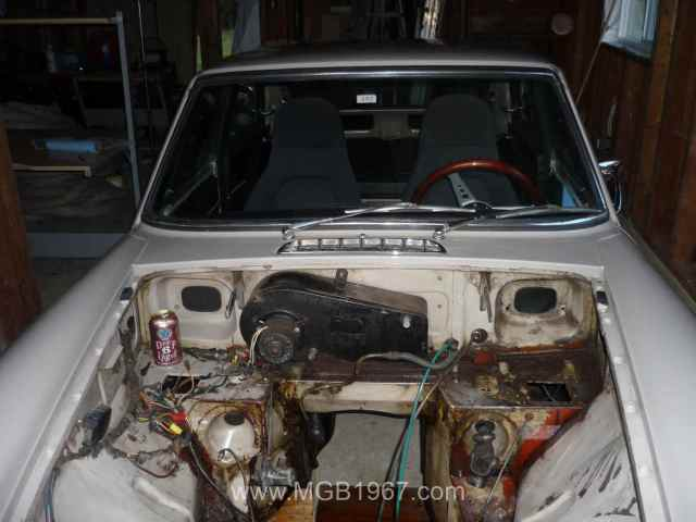MGB GT engine compartment with heater box and beer can