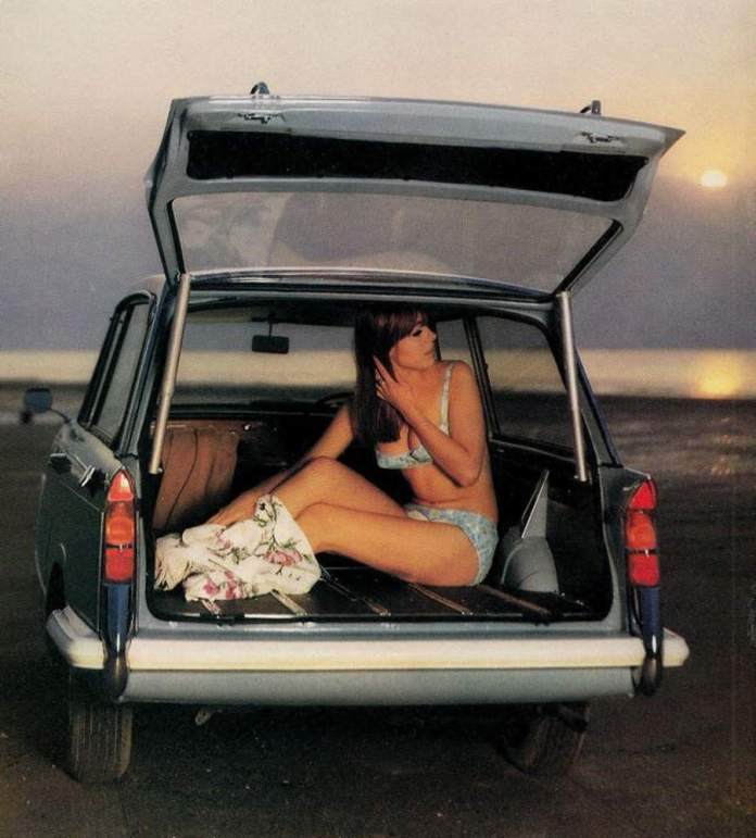 Bikini gal in trunk at beach