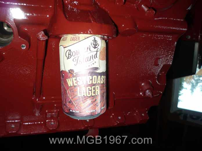 MGB engine block holding a cold beer