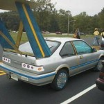 Dumb looking Japanese car with tin foil hubcaps