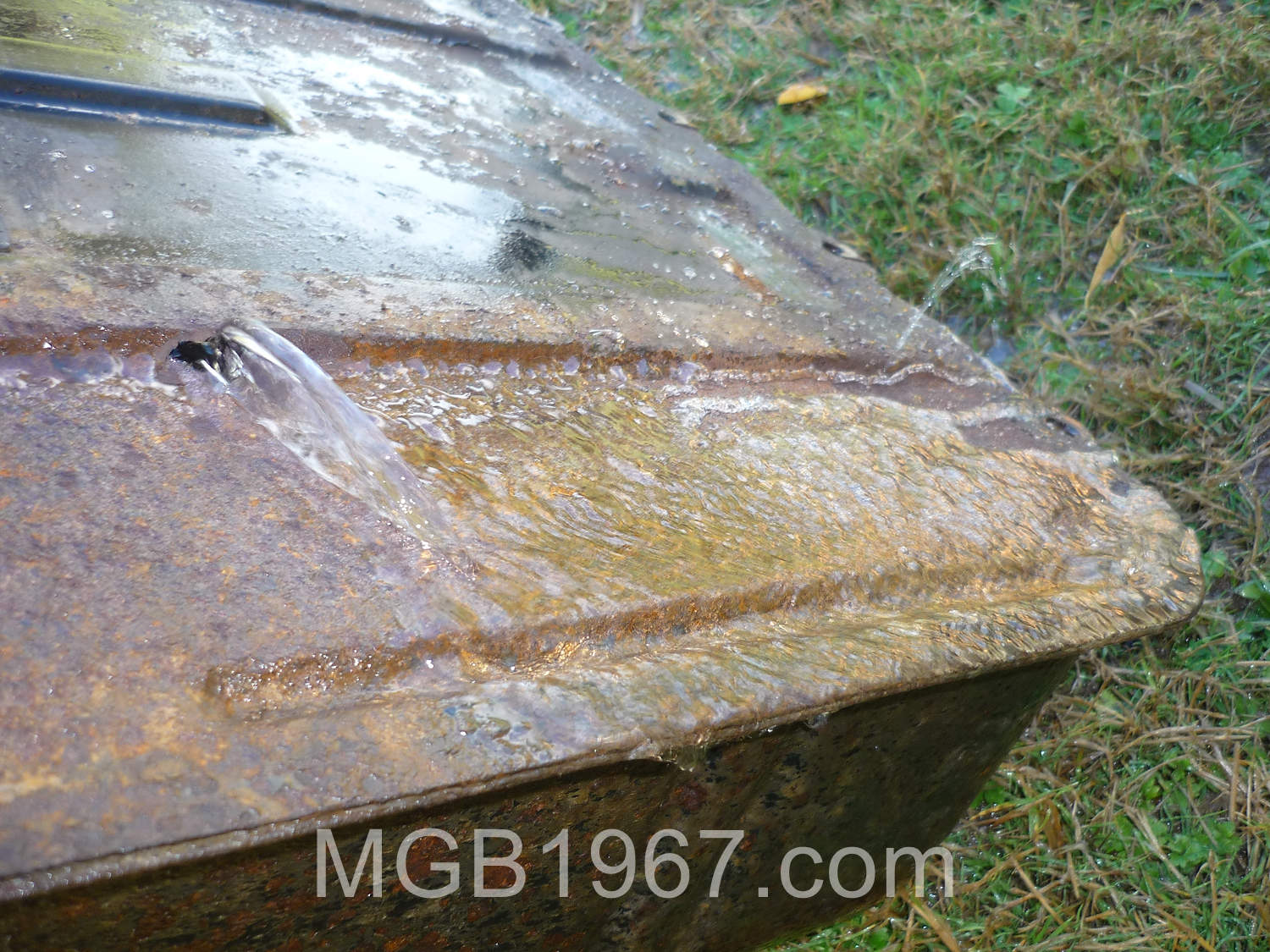 Rusted out MGB GT gas tank