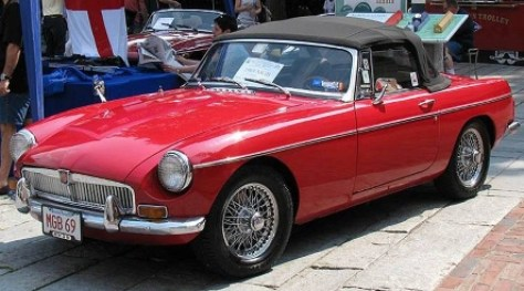 "r. Dean Saluti's 1969 MGB, the ""Red Jewel,"" on display at the Boston Area MG Club Faneuil Hall British Car Day event."