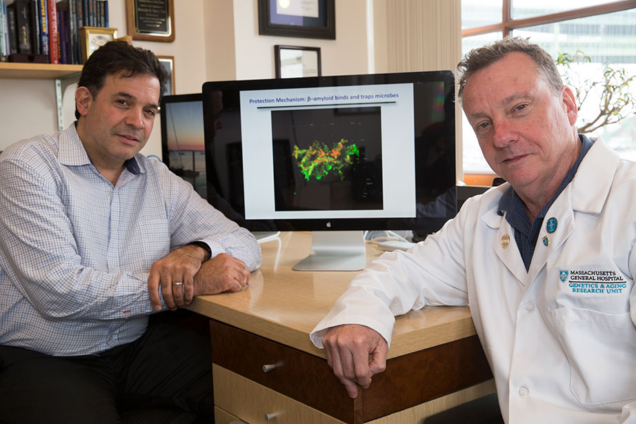 Alzheimer's researchers Rudy Tanzi, left, and Robert Moir are working on finding an infectious cause of Alzheimer's disease.Jon Chase/Harvard Staff Photographer