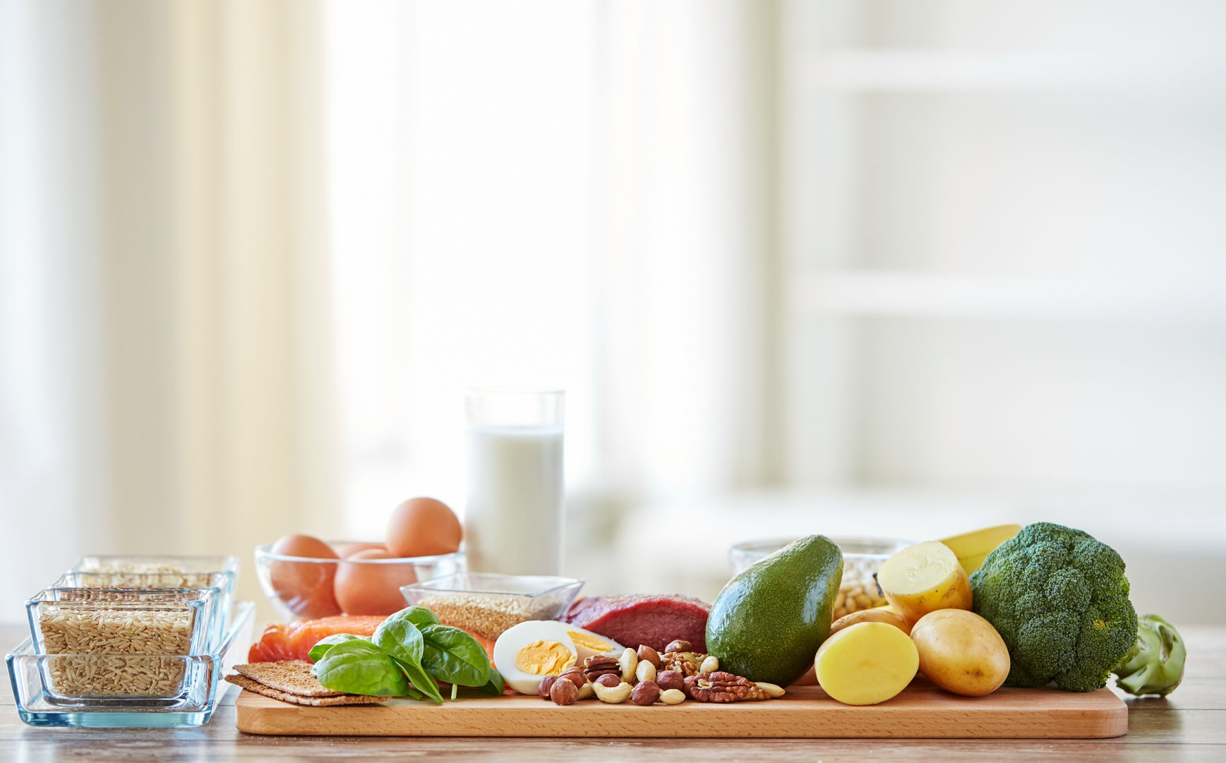 53927720 - balanced diet, cooking, culinary and food concept - close up of vegetables, fruits and meat on wooden table
