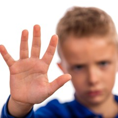 Boy with raised hand