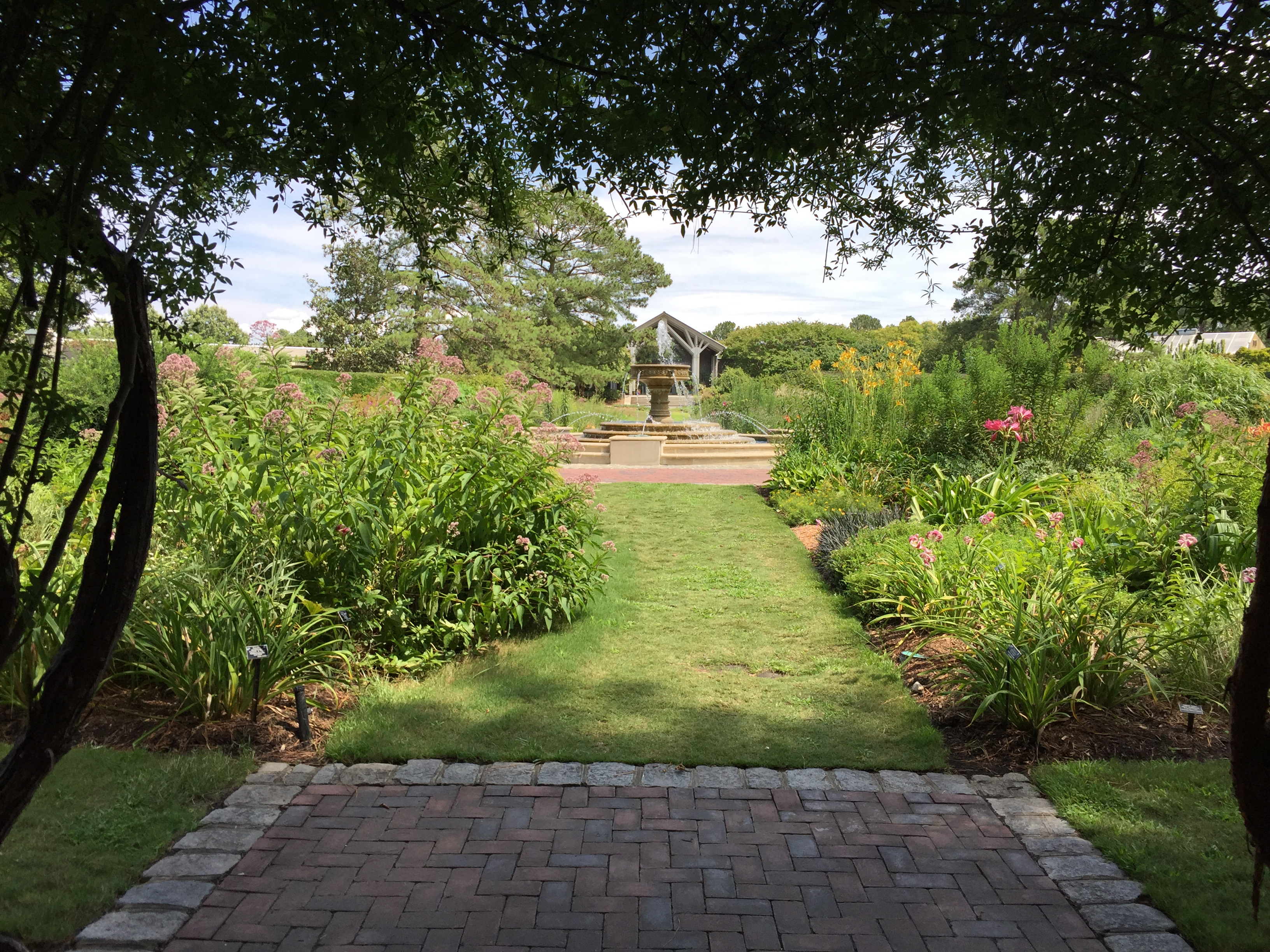 A covered entrance to the Perennial Garden leads to a central fountain. Photo © 2018 Elaine Mills
