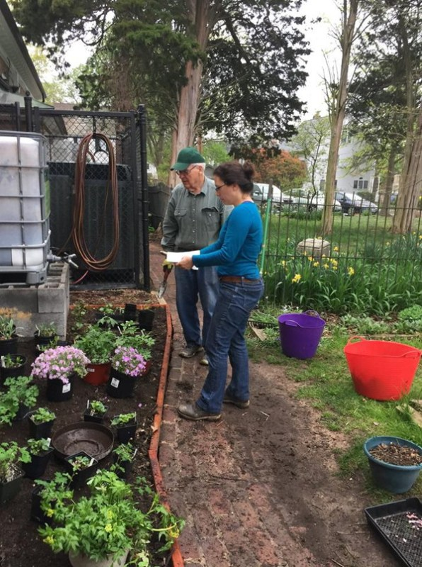 Ana Karla and Shrive confer about placement of plants.