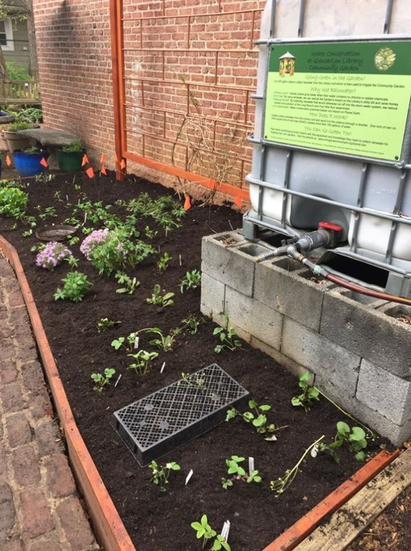 The finished bed with a potting tray to mark where a stepping stone will go and a dish to mark where a butterfly soak will go.