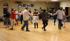 Stephanie Marie, of Charlotte, NC, was the caller for the ContraCola dance on Feb. 18. Half an hour before the dance begun, she provided a mini dance lesson to beginners.