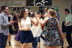 USC students, Shannon McDonald and Samantha Fladung, perform a portion of a contra dance in which the female partners circle each other between the male partners.