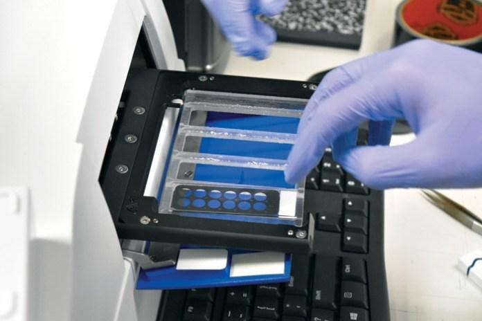 Loading-the-Micro-Reader----PathogenDX-DNA-testing-of-cannabis_CGC_0822_photo-credit---Christian-Cizek_cc_web_mg magazine June 2018