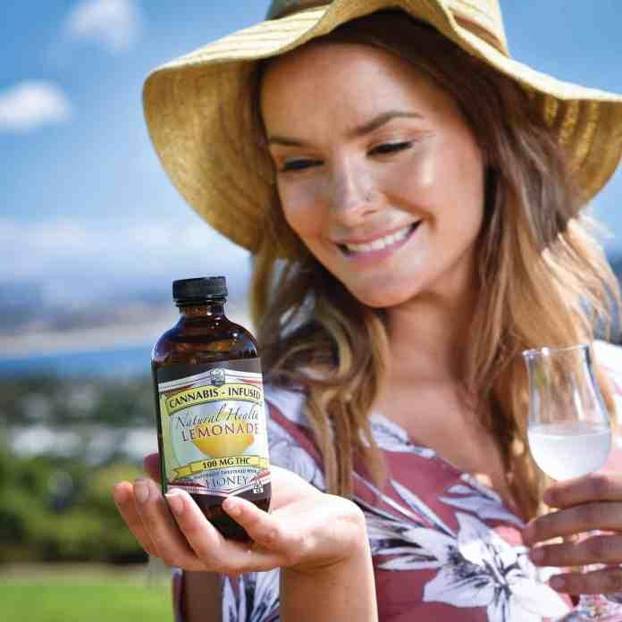 woman holding a bottle of good stuff tonic