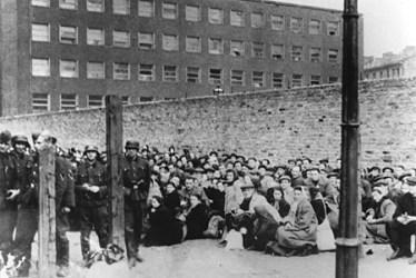Jews assembled under guard before deportation from Warsaw. Warsaw, Poland, July-September 1942. —Zydowski Instytut Historyczny Instytut Naukowo-Badawczy