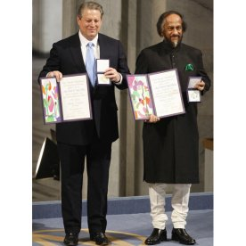 Nobel Peace Prize laureates, Rajendra Pachauri and Al Gore pose on the podium with their diplomas and gold medals