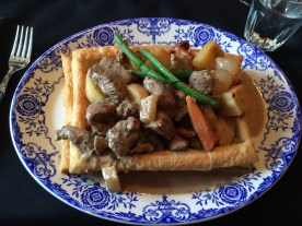 sauté of veal gently simmered with mushrooms and Quebec root vegetables flambé with cognac on a flaky pastry.