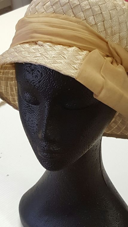 Woven straw hat. Orange, From the Leila Campbell estate