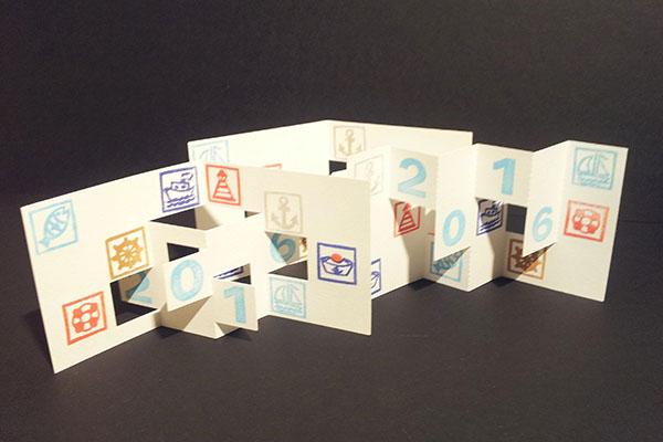 Ensemble des trois cartes de voeux 2016, kirigami avec motifs Marine