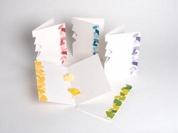 Carte en kirigami avec frise dessinée, vue de différents modèles