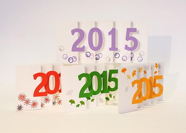 Carte de voeux 2015 MHT Pop up en papier découpé en accordéon. Vue d'ensemble de plusieurs modèles