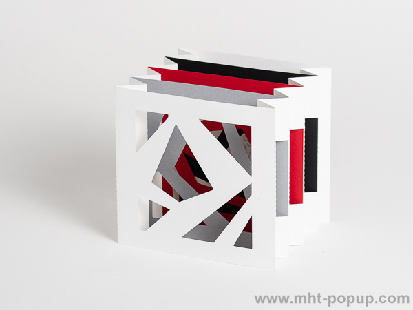 Livre d'artiste tunnel, modèle Abstraction blanc, vue de côté du livre déplié